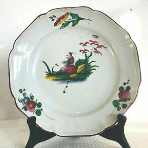 assiette en faïence polychrome décor paysage au chinois . XIX siècle.