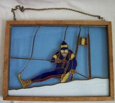 framed stained glass panel of down hill skier