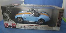 4Shelby Collectibles 1965 Shelby Cobra 427 S/C 1:18 Light Blue W Orange Stripes