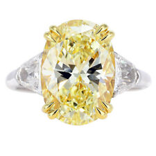Fancy Yellow 5.55 Carat Oval Cut Platinum Diamond Engagement Ring GIA Certified