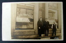 1914 REAL PHOTO POSTCARD MEN STANDING IN FRONT OF THE FIRST NATIONAL BANK OHIO