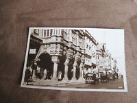Real photographic Devon Postcard -- Street scene with old cars -  Exeter