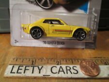 HOT WHEELS '70 Yellow TOYOTA CELICA HW City 2013 - Long Card - New FOR 2013!