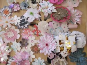 Over 60 handmade paper flowers, created by me using either die cuts or machine