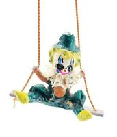 Clown on Swing like Paper Mache