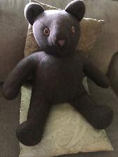 teddy bear hand made from man's coat