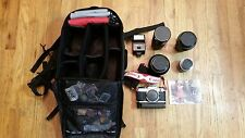 Canon AE-1 Program, Autowinder, Flash, Lens extender, Backpack case, Filters