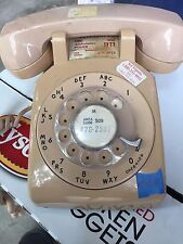 Vintage phone made by western electric , rotary dial , tan