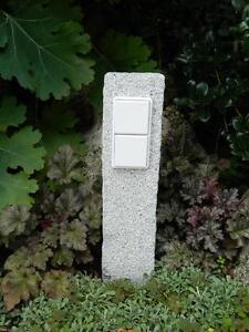 Gartensteckdose mit Schalter in Granitpalisade, Außensteckdose, gestockt