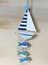 Hanging boat with fat fish.Fishing, coast, nautical decoration. Shoeless joe