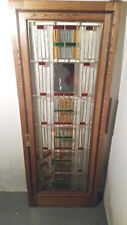 Custom made Oak Pocket doors, Custom leaded glass and wood inlay with hardware