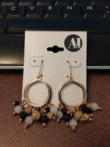 A&I gold dangle circle hoop earrings with brown, black and white beads