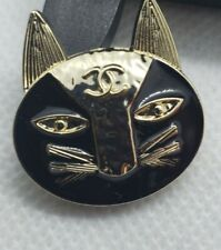 1  black with gold cat button 24 mm