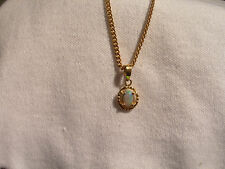( Lot 699 ) 14k Gold Pendant pale green coloured Opal stone in a simple setting.