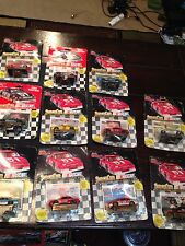11 NASCAR  Collectible Stock Cars - Cards & Display Stand