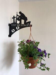 Lest We Forget kneeling soldier hanging basket bracket.