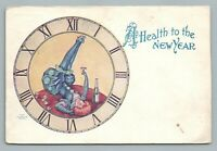 Cocktail-Drinking Harlequin Woman in Clock Face—Antique Ullman Postcard 1906
