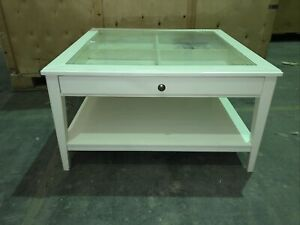 IKEA wooden glass top coffee table