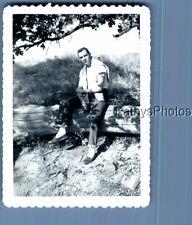 FOUND B&W PHOTO N_2178 MAN SITTING ON LOG IN SHADE
