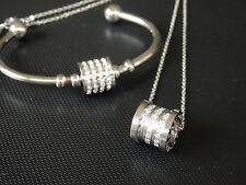 white gold open cuff with cz stone tumbler pendant necklace and bracelet