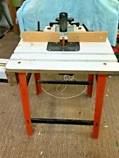 ROUTER WITH TABLE AND CAST IRON FENCE