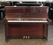 Streicher upright piano with a mahogany case.  88 notes. 3 pedals.