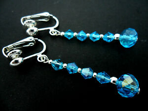 A PAIR OF DANGLY BLUE GLASS CRYSTAL SILVER PLATED CLIP ON  EARRINGS.