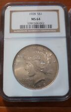 1928 PEACE SILVER DOLLAR ** NGC CERTIFIED MS 64 KEY DATE