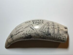 Faux scrimshaw whales tooth engraved with whaling scene