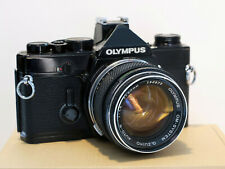 Olympus OM-1 - black - 35mm Film Camera Body with 50mm f/1.4 lens w/ grid focus