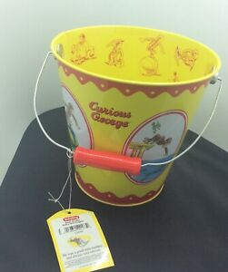 tin sand pail toy Schylling curious george old store stock beach toy