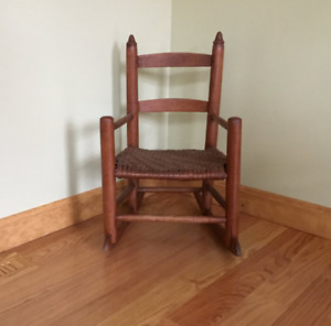 wooden child's  Solid wood frame with woven seating.