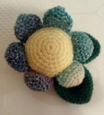 Cute yellow, blue and green amigurumi flower brooch