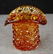 High Hat Figurine in Amber colored glass.