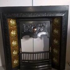 original antique cast iron fireplace insert with original tiles.