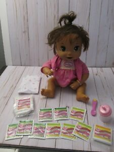 K Baby Alive Doll Soft Face English/Spanish  W/ Bottle, spoon food  Diaper Lot