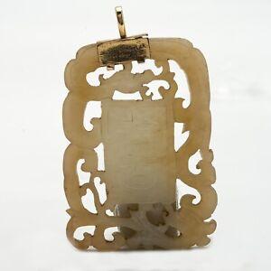 A Celadon Jade archaistic inscribed plaque