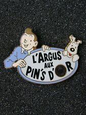 pin's TINTIN L'ARGUS AUX PIN'S D'OR variante 1 - dim : 45x31 mm, hergé , bd