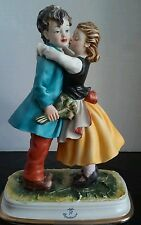 Capodimonte Kissing Girl and Boy Figurine