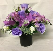 beautiful artificial flower arrangement in a memorial grave vase / crem pot