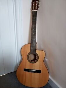 unbranded classical electro acoustic guitar solid top cutaway with hardcore