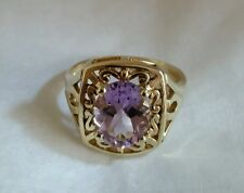 A 9ct yellow gold Dress Ring .Claw set with a Amethyst gemstone . London 1993