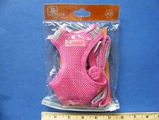 pink harness with leash for small pet.