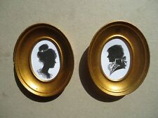 Pair of  miniature  silhouettes  in  gold oval frames