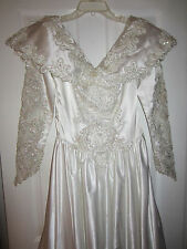 Beaded Bridal Gown Size 12 with Long Train Marionat of New York