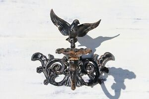 Mid-Century, French Cast Iron Sconce depicting a Bird