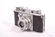 Minolta-35 rangefinder camera by Minolta C.K.S with Super Rokkor f/2.8-45mm lens