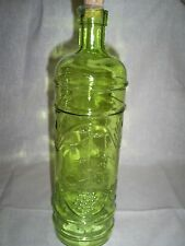 "One 12""Tallx10 Circum. in Green Glass Bottle with Raised Modern Design"