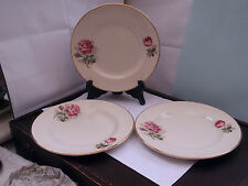 THREE WASHINGTON POTTERY  SIDE PLATES  WITH A PINK  ROSE BUD AND LARGER ROSE