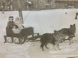 Antique EARLY 1900 RPPC Children Pulled by Sleigh Huskies Dog Snow Vtg Postcard